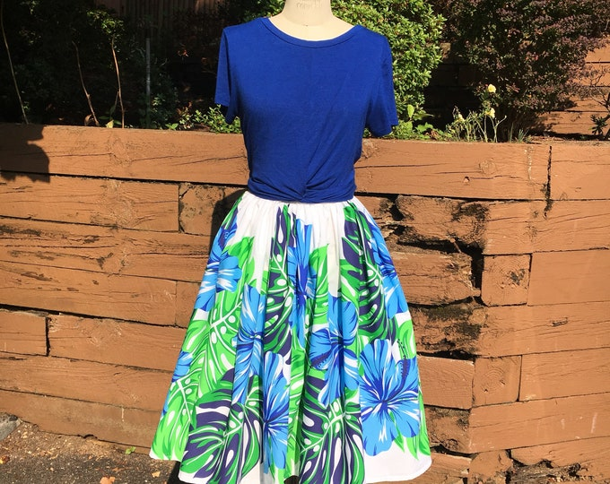 White Tiki Skirt with Blue Hibiscus Border
