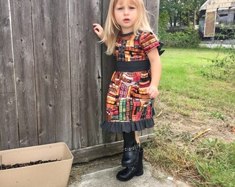 Book Dress with Sash & Ruffle Hem