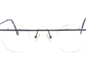 030c646d7f Vintage European Club LA 5217R Rimless Small Round 38 mm Eccentric  Statement Black Thin Metal Minimalist Eyeglasses Austria 90s NOS