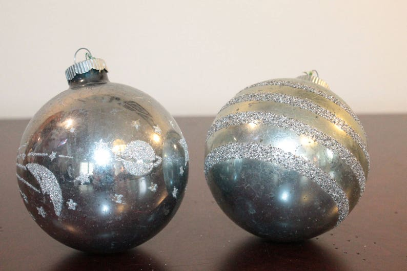TWO \u2013 Two Shiny Brite Oversized Pale Blue Ornaments with Glitter \u2013 One Horizontal Stripes and One with Moon Shooting Stars and Saturn