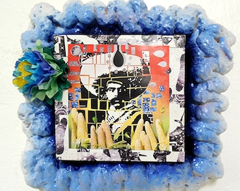 "Zapata collage with Bindi dot in fun frame with paper flower. 6""x6"" cradled wood support with expandable foam frame, painted w/paper flower"