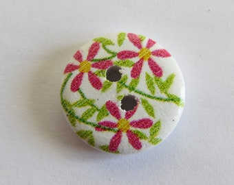 Round wooden button with yellow and pink flower pattern