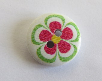 Round wooden button with green and pink flower pattern
