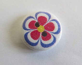 Round wooden button with purple and pink flower pattern