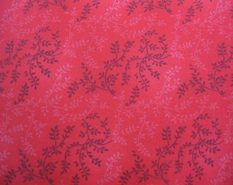 100 percent cotton fabric/red with vines/quilting/apparel/crafts/by the yard