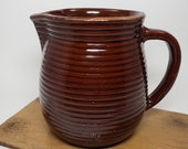 Western Stoneware Monmouth, IL Pottery Pitcher Jug, Ribbed Beehive Design, Maple Leaf Mark, Glazed Brown Stoneware Milk Pitcher