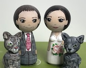 Wedding couple with two cats