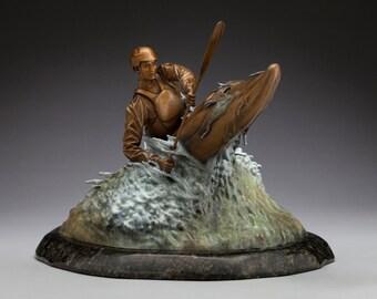 Bustin' Through A Smoker! - Bronze Kayaker Sculpture