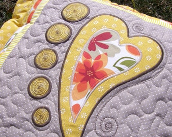 Pillow with heart appliqué