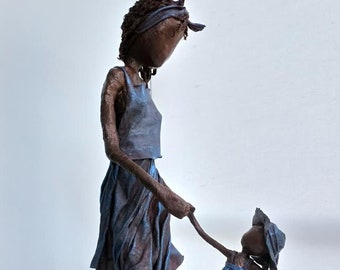 Sculpture of Mother and Daughter Dancing. Available