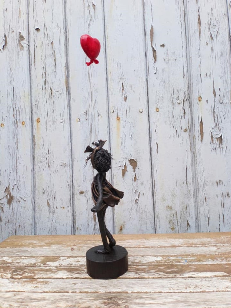 Girl with Red Heart Shaped Balloon in Black and Bronze. Mixed image 0