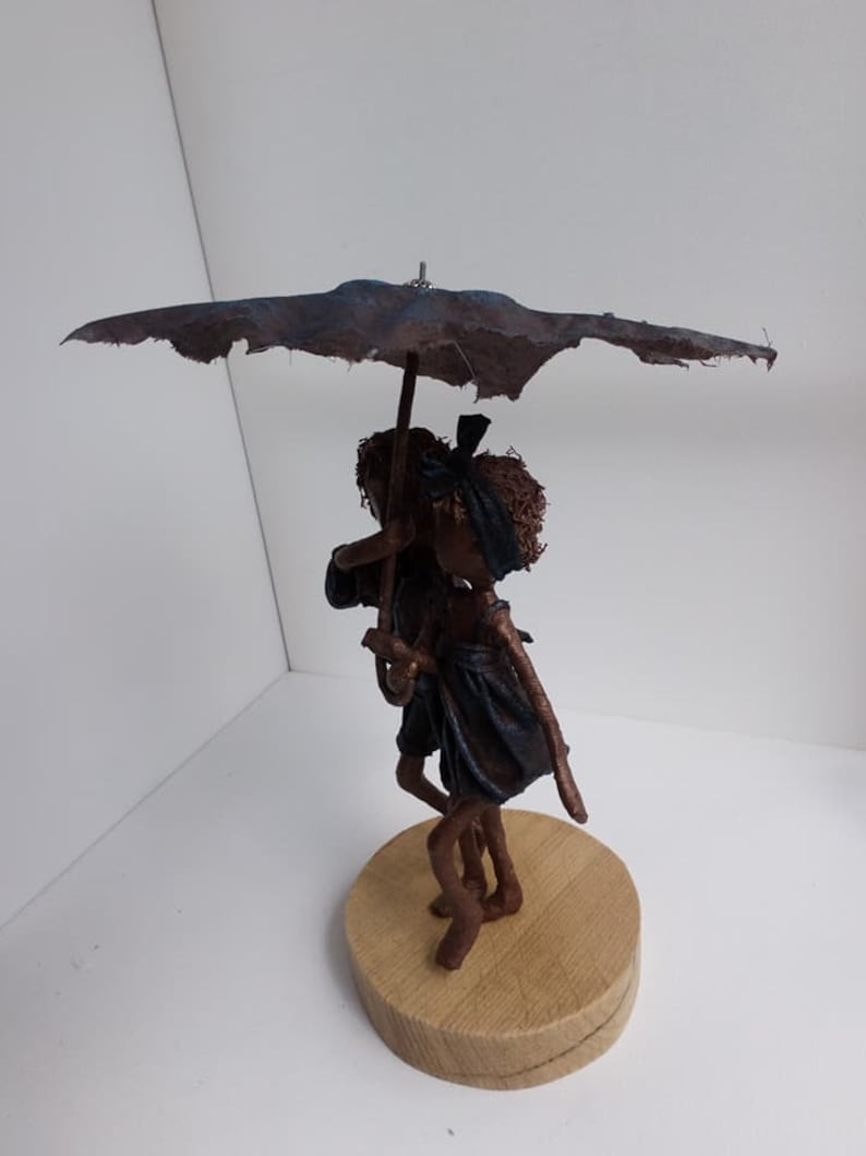 Rainy Days Sunshine. Sculpture of Children with umbrella. image 0