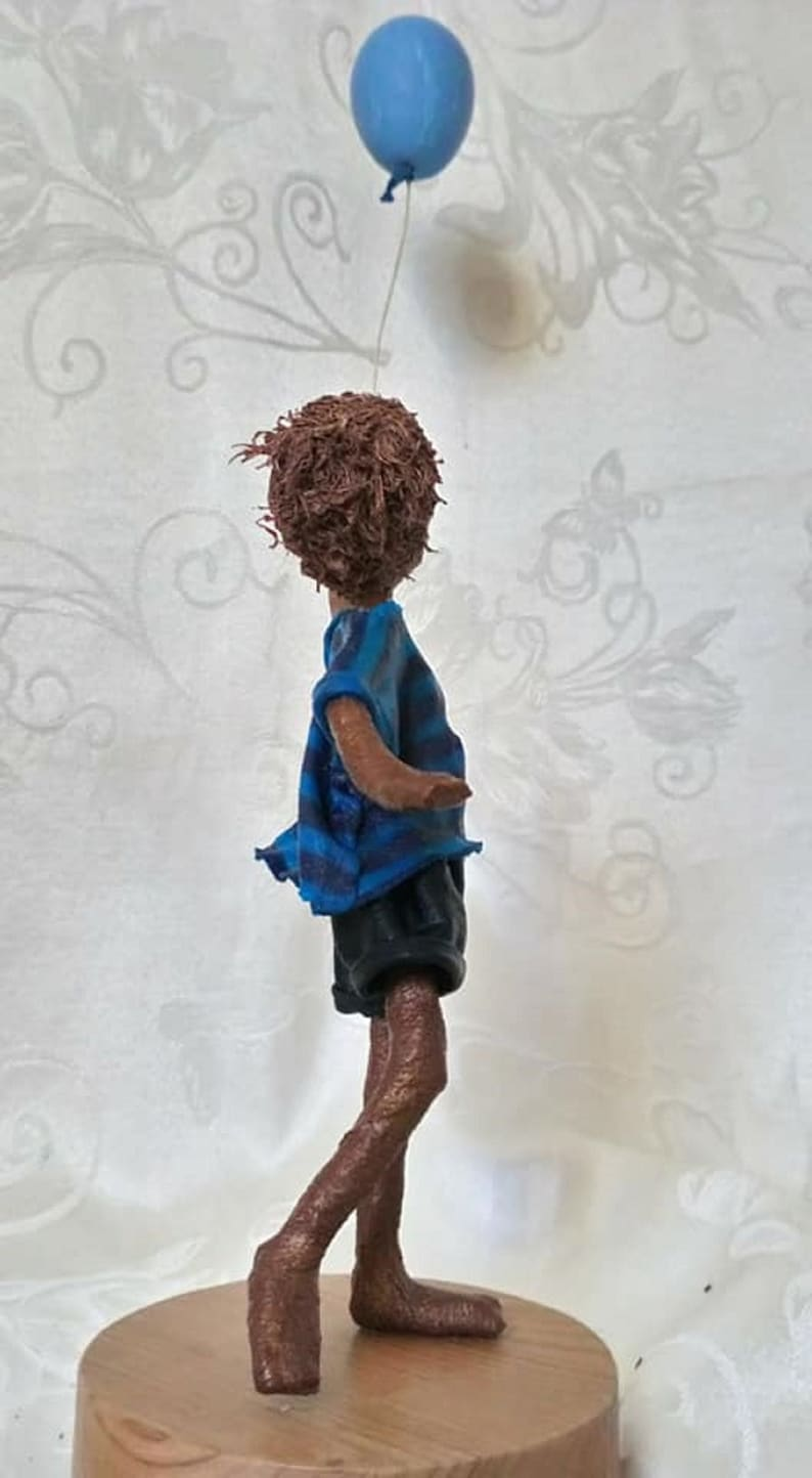 Boy with blue balloon. Mixed media sculpture. AVAILABLE image 0