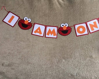 Sesame Street Elmo I am (age) banner. Great for birthday parties. Free Shipping. You pick age.