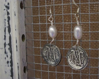 Monogram earrings of fine silver and freshwater pearls.