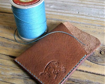 Minimalist bold leather, Kokopelli hammered, sewn over teal linen handmade card case