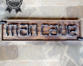 Man Cave Industrial Art Sign made of Steel Pipe and Fittings on stained wood - Made in America