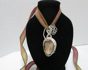 Sterling Silver, Wire Wrapped, Pendant.  Yellow/ Brown Stone