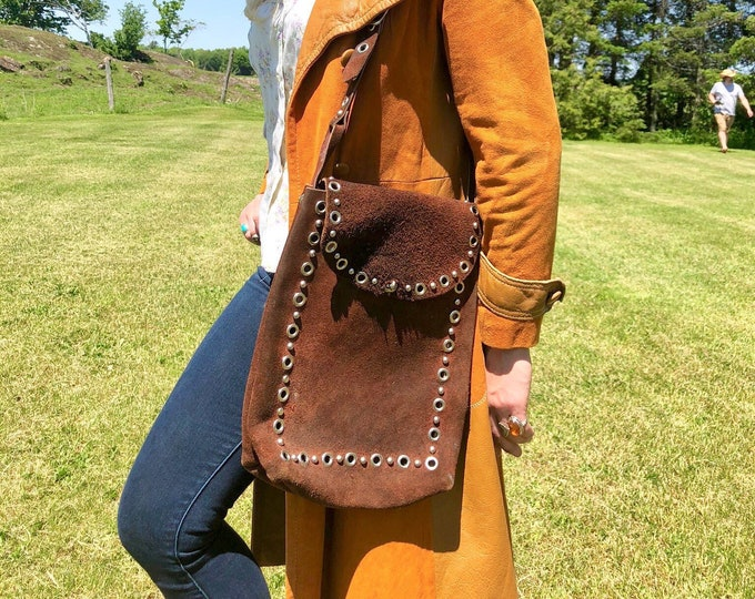 Featured listing image: 1940s Brown Suede Riveted Rectangular Leather Saddle Bag with Long Adjustable Strap and Turnkey Clasp
