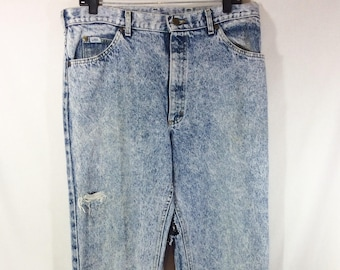 Women's 1980s High Waisted Distressed Acid Wash Lee Jeans size 34 x 34