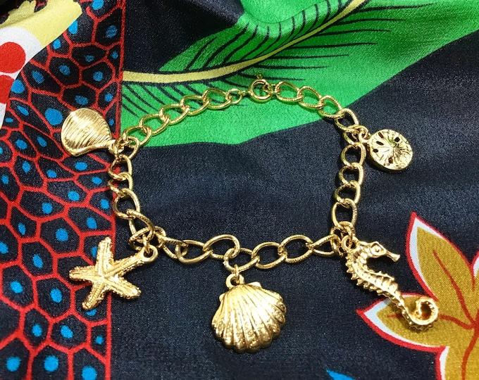 Featured listing image: 1970s Nautical Gold Tone Charm Bracelet