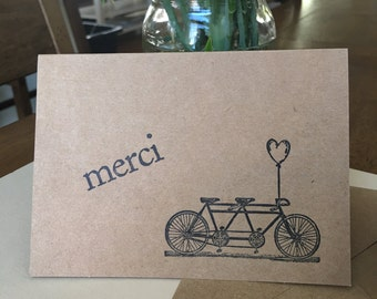 Greeting card, 'merci' and bike for two