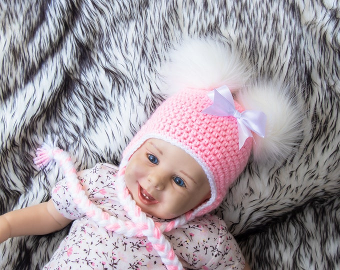 Pink double pom pom hat with bow, Newborn girl hat, Baby girl hat, Earflap hat, Crochet baby hat, Fur pom pom Winter hat, Toddler girl hat