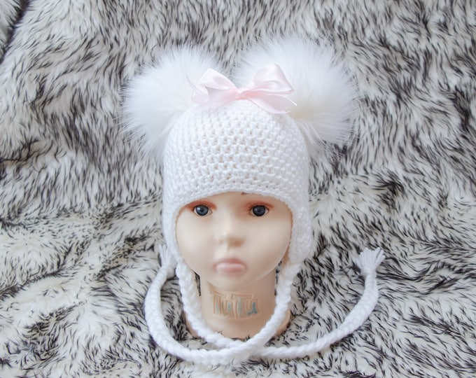 White Double pom Baby girl hat with bow, Newborn girl hat, Baby girl gift, Earflap hat, Crochet hat, Fur pom Winter hat, Toddler girl hat