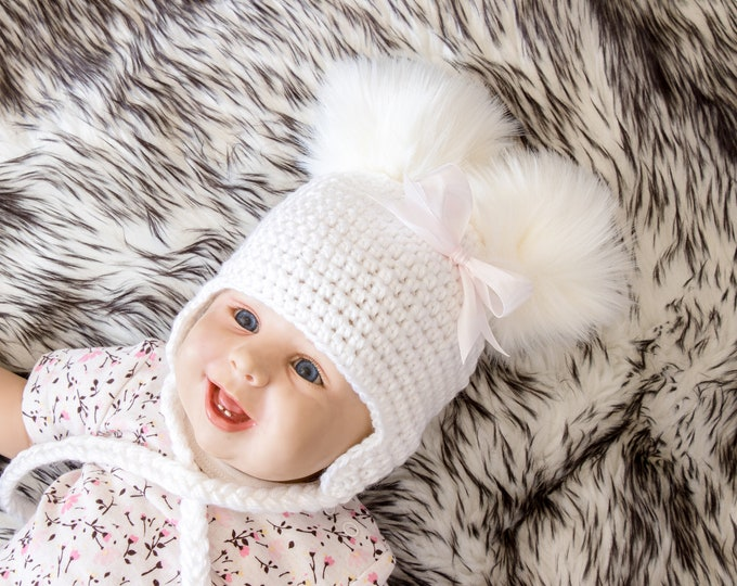White Double pom Baby girl hat with bow, Newborn girl hat, Baby girl gift, Earflap hat, Crochet hat, Fur pom Winter hat, Toddler girl hat