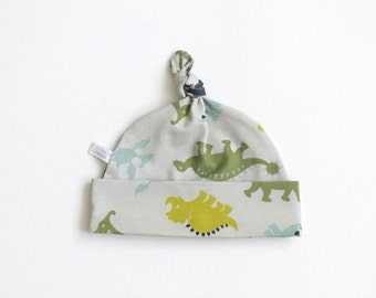Organic cotton baby hat with dinos