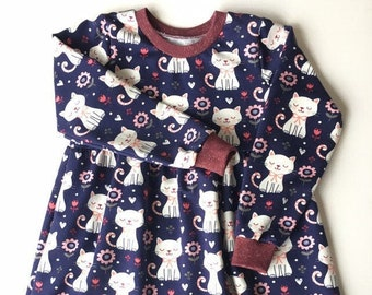 Blue dress with cats. Sweater fabric