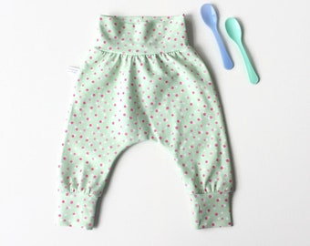Green harem pants with white and pink dots
