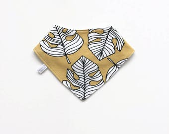 Yellow baby bandana bib with monstera leaves. Baby or toddler bibdana. Cotton and flannel. Drool bib. Organic cotton