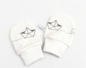 White geometric baby mittens with paper boats