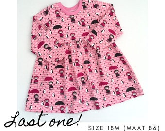 Girl's dress with girls, penguins and small clouds