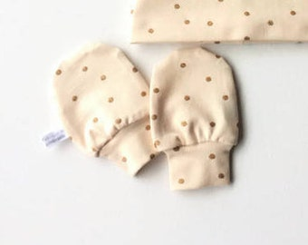Soft peach mitts with gold dots