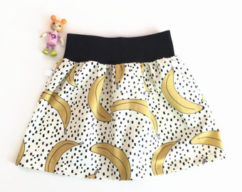 White skirt with bananas and black dots