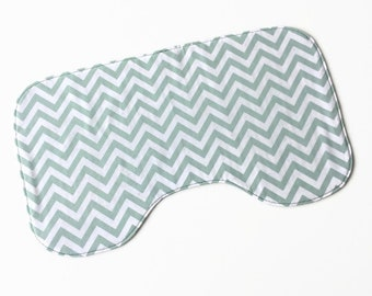 Contoured burp rag. White cotton with green chevron.