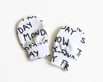 White baby mittens with weekdays