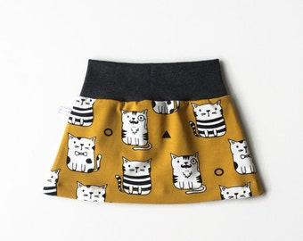 Yellow skirt with cats