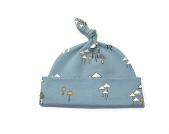 Light blue hat with mushrooms