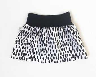 White skirt with black dots