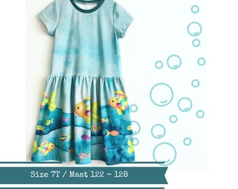 Last one: size 7T. Girls dress with colourful fish