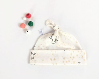 Off white organic baby knot hat with stars, cats and deer