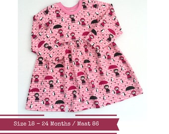 Girl's dress with girls, penguins and small clouds. Size 18 - 24 months