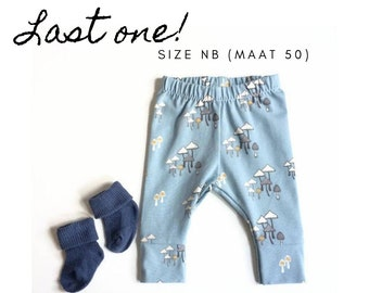 Blue baby leggings with mushrooms. Size NB.