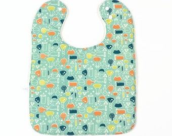 Large baby or toddler bib. Organic cotton with chemist's jars and bottles. Teal, orange, yellow. White cotton terry back. Geeky nerd gift