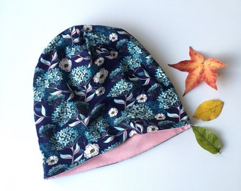 Beanie hat, slouchy hat. Kids to adult sizes. Dark blue with flowers. Pink reverse side. Reversible beanie hat