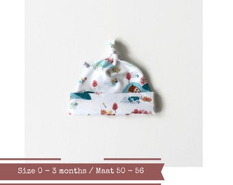 White baby hat with small houses and farms. Size 0 - 3 months