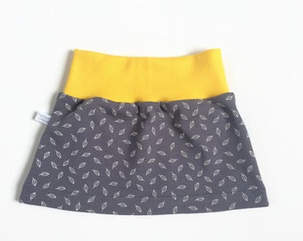 Grey baby or toddler skirt. Yellow waist band. Grey skirt with small white leaves. Sizes 3 Months - 4T. Girl's skirt, small skirt.